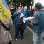 Koordinator Aksi Chotibul Umam Sirait Saat Memimpin Aksi Unjuk Rasa Depan Kantor PT. Perkebunan Nusantara, Kamis (21/10/2021)